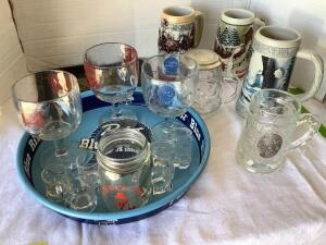 Round Pabst Blue Ribbon tray, two Budweiser Christmas steins, one Miller Stein, Heidelberg W Germany stein, other misc beer glasses