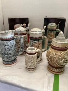 Four Avon ceramic hinged lid beer steins and one small Avon stein