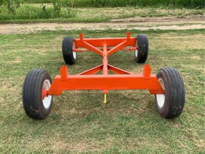 heavy duty wagon running gear four implement tires on six hole rims painted AC orange colors