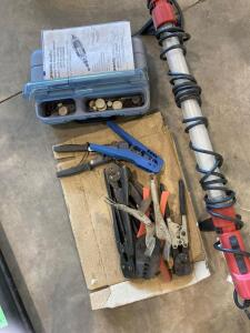 Dremel tool with assorted bits, assorted wire crimping pliers, and a Craftsman fluorescent portable work light