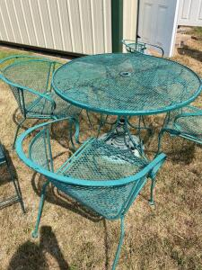 Expanded metal table, four chairs, umbrella stand and two matching side tables.