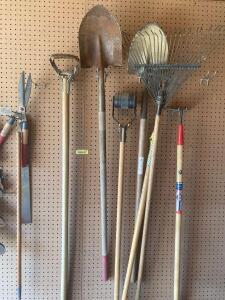 Various lawn and garden tools-hedge trimmers, roundpoint shovels, leave rake, hoe, electric hedge trimmers, loppers, handsaw