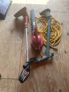 Electric leaf blower, two electric string trimmers and a heavy duty drop cord