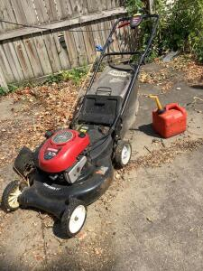 "Craftsman ez•walk 6.75 hp 21"" gas powered rear bagging mower and a gas can."