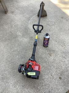 Craftsman gas powered trimmer Model 316.79447 and a can of 2 cycle fuel