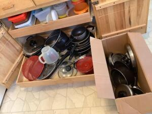 Storage containers, pots and pans with lids, colander, flat griddle Includes items in bottom of stove drawer See photos