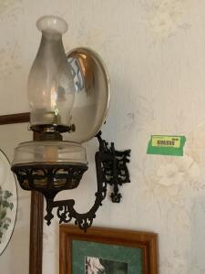 Cast iron wall bracket with oil lantern and reflector Buyer will need to remove from wall  **Matches lamp in Lot 9643**