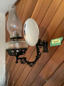 Cast iron wall bracket with oil lantern and reflector Buyer will need to remove from wall **Matches lamp in Lot 9640**