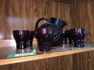 Ruby red pitcher and six glasses