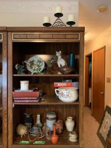 Contents of wall unit-hummingbird figurines, pottery including Royal Haeger vase, books, candles, holiday and more