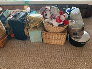 All items under table include vintage games, picnic basket, wicker trashcan, stock pots, nativity scene, vintage children's toys, personal cooler and many other items
