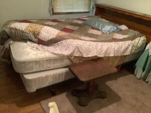 Queen size bed with mattress and box spring includes linens and headboard and small side table. Mattress is a Correct Comfort Heritage Extra Firm
