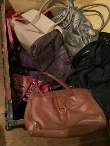 Quantity of purses and a tote to carry them home in,  also two over the door racks for shoes and clothing