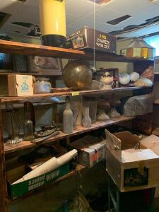 All items on center shelving unit include wok set, shade covers, oil lanterns, Corelle dishes, old bottles, vintage scale, wicker shelf, punch set, Royal typewriter (keys stuck down) and much more