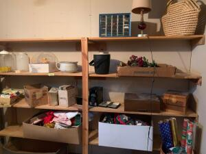 Contents of shelves along right side of wall include Christmas decorations, empty flatware chest, ice bucket, wicker bag, 30 drawer bin full of beads, empty shell casings
