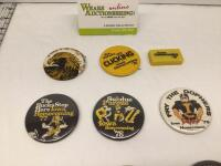 Seven Iowa Homecoming badges and one clicker-1975, 1976 with corresponding clicker, 1977, 1978, 1979, 1980, 1981 and 1982 - 2
