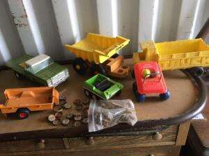 Toys-Nylon Metal flat bed Truck, Mattel dump truck, Tonka all-terrain vehicle Fisher-Price bouncing buggy and old Coca-Cola bottle caps
