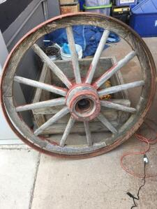 Old wooden Wagon wheel with metal ring loose