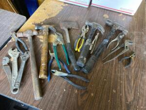 Hammers, pliers, axe, wire cutters