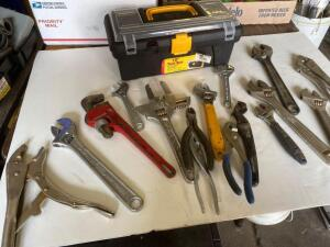 Vice Grips, pliers, wire cutters, crescent wrenches, pipe wrench, black tool box