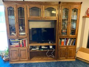 Oak entertainment center with lead glass doors, 85x17x74, two sections