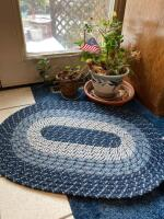 Live plants, blue small oval rug, white metal plant stand, outside timer, nippers