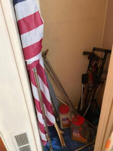 Flag, canes, grabbers, ice melt (contents of closet)