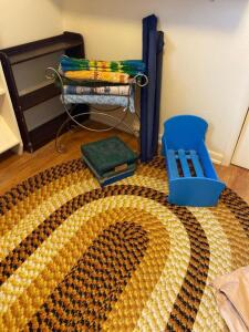 Book shelf, vanity stool, rugs, braided rug, blue baby play crib, stool