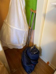 Sleeping bags, crutches, hangers, clothes bag