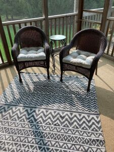Two wicker chairs, 5x7 area rug, table and wind chime