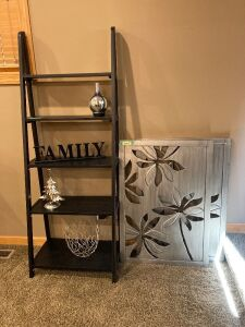 "6' H x 27"" W bookcase with aromatherapy diffuser decor and two matching pieces of wall art"