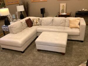"3-piece cream colored leather sectional with throw pillows. Sectional measures 9' 4"" L"