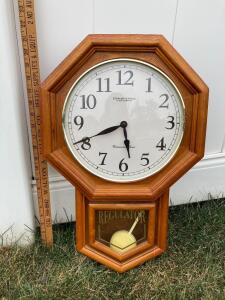 "Sterling & Noble Schoolhouse Regulator Westminster chime clock. Model 22071. Measures 21"" tall."