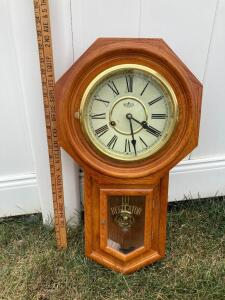 "D & A Regulator clock. Key included. Measures 23"" tall."