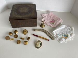 Vintage military uniform buttons and pins, Space Needle pencil, charm bracelet, brooch, handkerchiefs, old letter box, brass bell made in Guatemala.