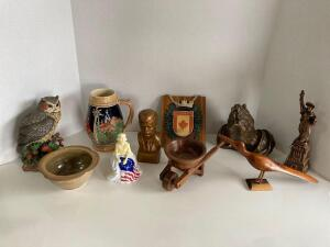Vintage items for your bookcase! German beer stein, metal Statue of Liberty, ceramic JFK, Jamaican carved bird, Lenzini Artworks 1964 praying hands an