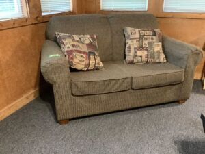 Two cushion Marshfield Furniture loveseat and throw pillows Measures 60 x 36 x 36