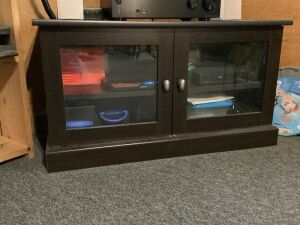 Modern black media cabinet w one adjustable shelf measures 36 x 18 x 19, contents not included