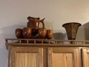 Four groups of decor-wooden water pitcher and 6 goblets, tray, dresser box, two metal vases and a round decorative metal saucer