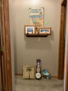 Think beach-Shelf and all decor includes art, throw pillow, wall clock, mantle clock, lighthouse painted on slate and more