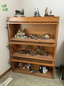 "Wildlife figurines in cabinet including Ducks Unlimited duck, Terry Redlin die cast truck by Ertl and Terry Redlin ""Country Milkhouse"""