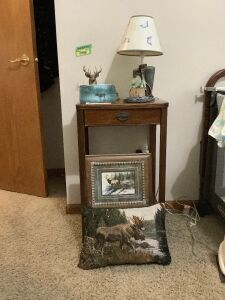 Single drawer phone stand measures 16 x 12 x 28, throw pillow, wall art, moose image on stone , lamp, deer figurine