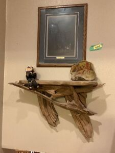 "Driftwood shelf with decor and ""Family Traditions"" by Scott Storm (signed) Driftwood measures 30"", picture measures 18 x 21"