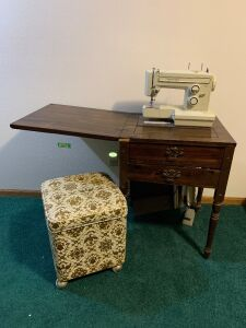 "Kenmore sewing machine Model 1525 with cabinet and sewing stool with goodies inside Cabinet measures 20 x 20 x 31 with a 20"" leaf"