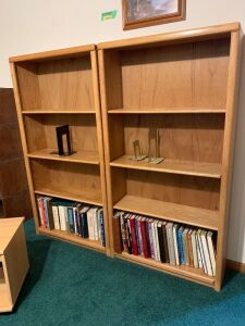 Two modern bookshelves and contents-Each measures 31 x 10 x 60 and have two adjustable shelves
