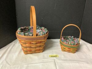 Two Longaberger baskets with liners and protectors Small basket is marked 1998 edition