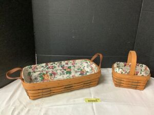 Two Longaberger baskets with liners and protectors