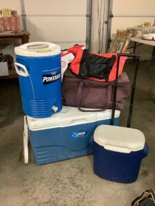 Powerade water cooler, Coleman personal rolling cooler, Coleman Extreme rolling cooler, two other bag style coolers