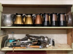 Coffee carafes, kitchen utensils, aluminum water pitchers, salt and peppers, small drinking glasses, creamers, sugars, pitchers
