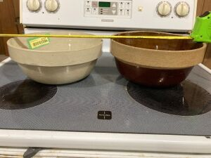 Pair of Crock bowls, both are 10 inches, tan one says Western Stoneware Company on the bottom, the brown one has no marking and is slightly chipped